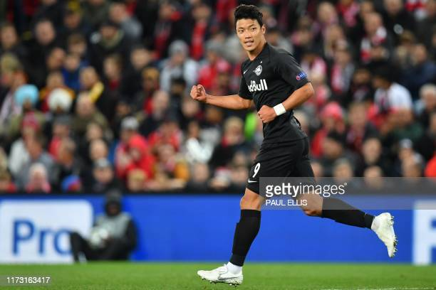 Salzburg's South Korean midfielder Hwang Hee-Chan celebrates after scoring their first goal during the UEFA Champions league Group E football match...