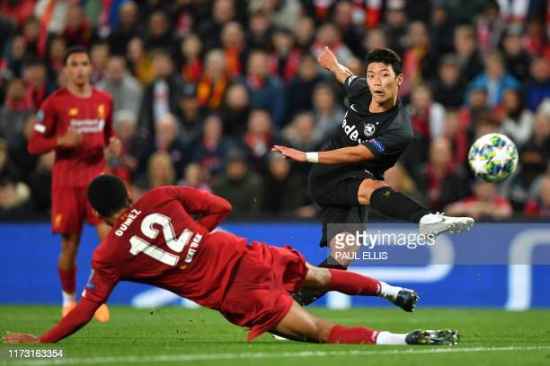 Salzburg's South Korean midfielder Hwang HeeChan shots to score their first goal during the UEFA Champions league Group E football match between...