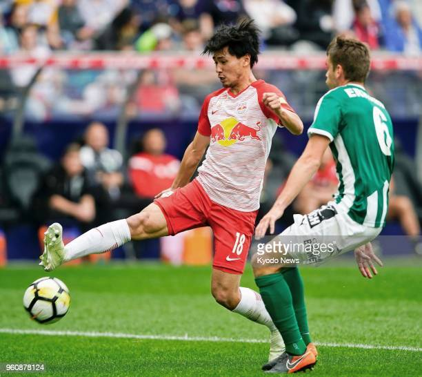 Salzburg's Takumi Minamino attempts to control the ball while being challenged by Philipp Erhardt of Mattersburg during the first half of Salzburg's...