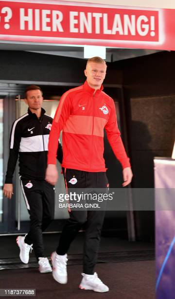 Salzburg's US head coach Jesse Marsch and Salzburg's Norwegian forward Erling Braut Haland arrive to give a press conference on the eve of the UEFA...