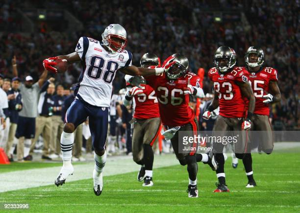 Sam Aiken of the New England Patriots scores the third touchdown during the NFL International Series match between New England Patriots and Tampa Bay...