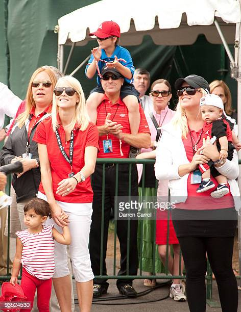Sam Alexis Woods Elin Woods Josefin Nordegrin and Charlie Axel Woods wait for Tiger Woods during the final round of the 2009 ATT National hosted by...