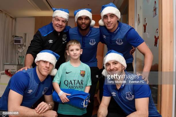 Sam Allardyce Cuco Martina Ramiro Funes Mori Ross Barkley and Leighton Baines during the visit of Everton players Christmas visit to Alder Hey...