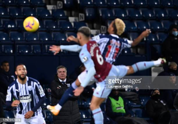 Sam Allardyce, Manager of Aston Villa watches Douglas Luiz of Aston Villa and Grady Diangana of West Bromwich Albion jump for a header during the...