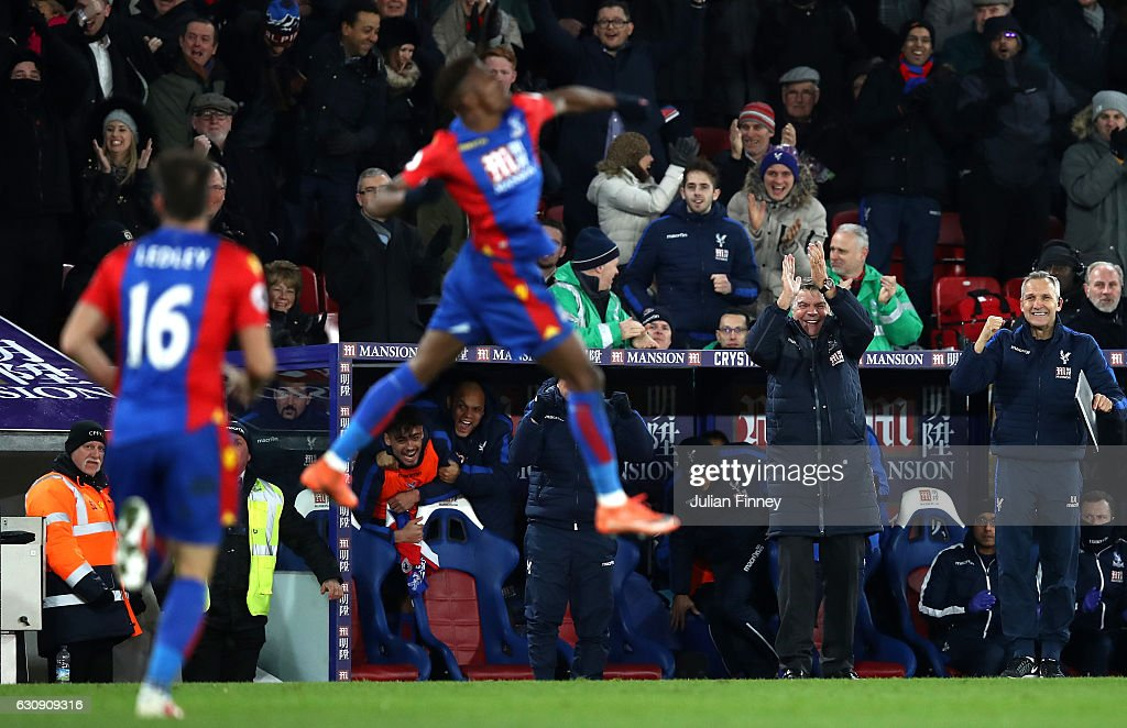 Sam Allardyce (2nd R), Manager of Crystal Palace celebrates as Wilfried Zaha scores his side's first goal during the Premier League match between Crystal Palace and Swansea City at Selhurst Park on January 3, 2017 in London, England.