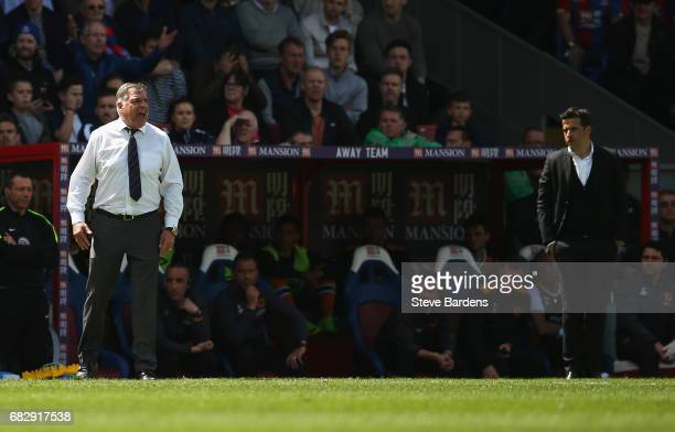 Sam Allardyce Manager of Crystal Palace gives his team instructions as Marco Silva Manager of Hull City looks dejected during the Premier League...