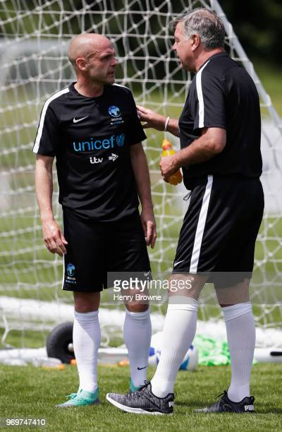 Sam Allardyce manager of England and Danny Murphy of England in discussion in training during Soccer Aid for UNICEF media access at Fulham FC...