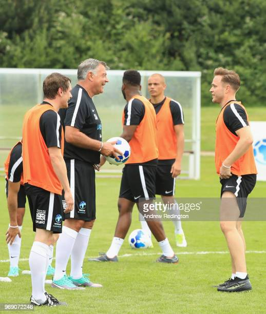 Sam Allardyce manager of England and Olly Murs in discussion as they take part in training during a Soccer Aid for UNICEF media session at Fulham FC...