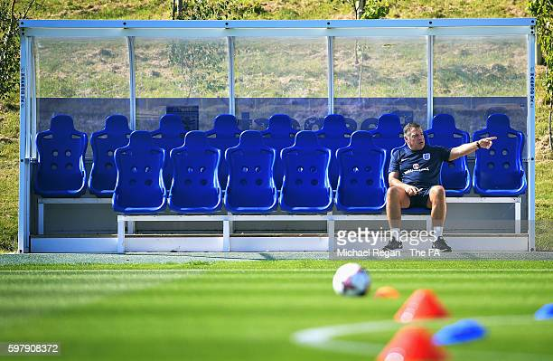 Sam Allardyce, manager of England gives instructions from a dug out during an England training session at St George's Park on August 30, 2016 in...