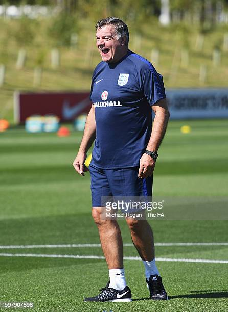 Sam Allardyce, manager of England laughs during an England training session at St George's Park on August 30, 2016 in Burton-upon-Trent, England.
