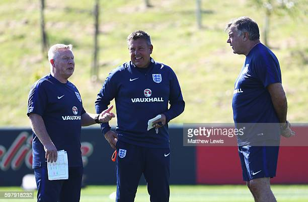 Sam Allardyce , manager of England talks with Craig Shakespeare and Sammy Lee during an England training session at St George's Park on August 30,...