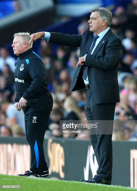 Sam Allardyce Manager of Everton and Sammy Lee Assistant manager give instruction to their team during the Premier League match between Everton and...