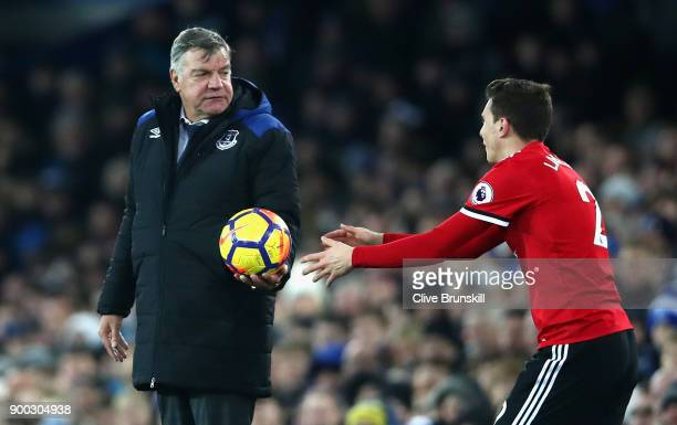 Sam Allardyce Manager of Everton passes the ball back to Victor Lindelof of Manchester United during the Premier League match between Everton and...