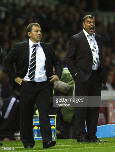 Sam Allardyce manager of Newcastle United reacts as Billy Davies manager of Derby County looks on during the Barclays Premier League match between...