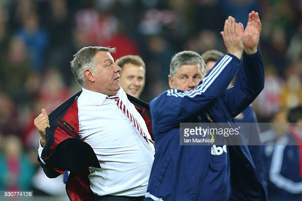 Sam Allardyce, manager of Sunderland celebrates staying in the Premier League after victory during the Barclays Premier League match between...