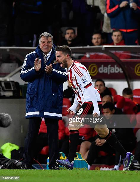 Sam Allardyce manager of Sunderland congratulates Fabio Borini on his second goal during the Barclays Premier League match between Sunderland and...