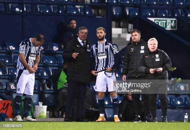 Sam Allardyce , Manager of West Bromwich Albion gives instructions to Charlie Austin of West Bromwich Albion as he and team mate Branislav Ivanovic...