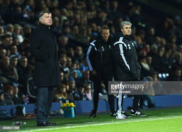 Sam Allardyce manager of West Ham United and Alan Irvine manager of West Bromwich Albion look on from the touchline during the Barclays Premier...