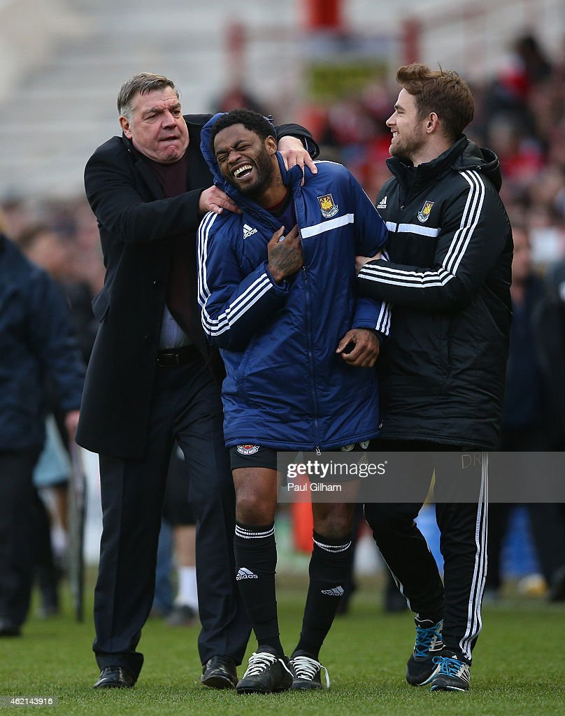 Sam Allardyce (L), Manager of West Ham United celebrates victory with Alex Song (c) of West Ham United during the FA Cup Fourth Round match between Bristol City and West Ham United at Ashton Gate on January 25, 2015 in Bristol, England.