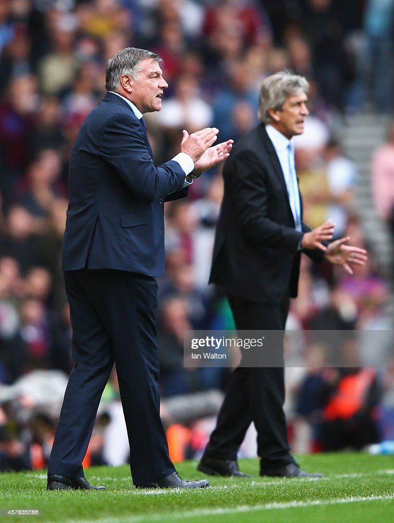Sam Allardyce, manager of West Ham United encourages his team with Manuel Pellegrini, manager of Manchester City during the Barclays Premier League match between West Ham United and Manchester City at Boleyn Ground on October 25, 2014 in London, England.