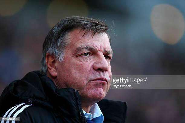 Sam Allardyce manager of West Ham United looks on prior to the Barclays Premier League match between West Ham United and Arsenal at Boleyn Ground on...