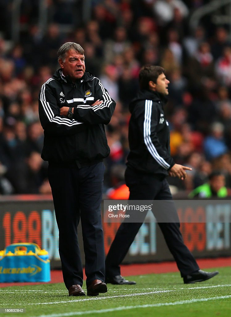 Sam Allardyce the West Ham manager and Mauricio Pochettino the Southampton manager look on from the sideline during the Barclays Premier League match between Southampton and West Ham United at St Mary's Stadium on September 15, 2013 in Southampton, England.