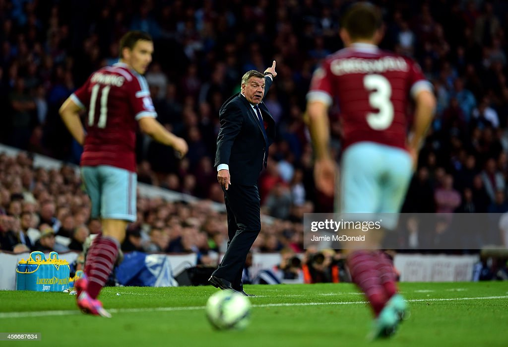 Sam Allardyce the West Ham manager signals to his players during the Barclays Premier League match between West Ham United and Queens Park Rangers at Boleyn Ground on October 5, 2014 in London, England.