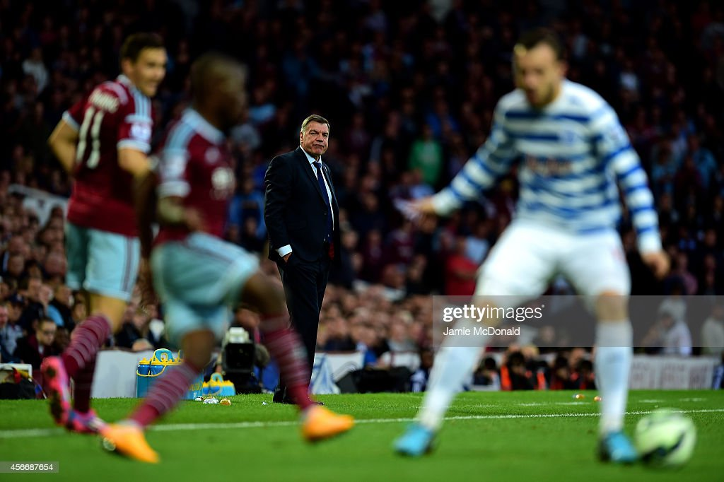 Sam Allardyce the West Ham manager watches the action from his technical area during the Barclays Premier League match between West Ham United and Queens Park Rangers at Boleyn Ground on October 5, 2014 in London, England.