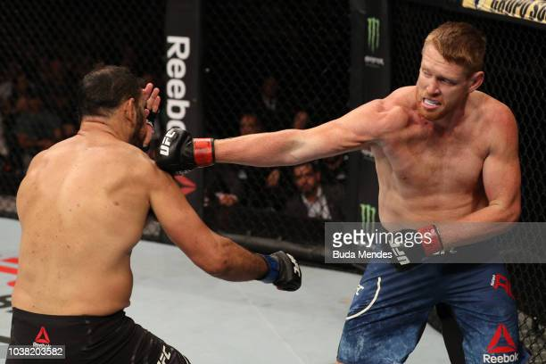 Sam Alvey punches Antonio Rogerio Nogueira of Brazil in their light heavyweight bout during the UFC Fight Night event at Ibirapuera Gymnasium on...