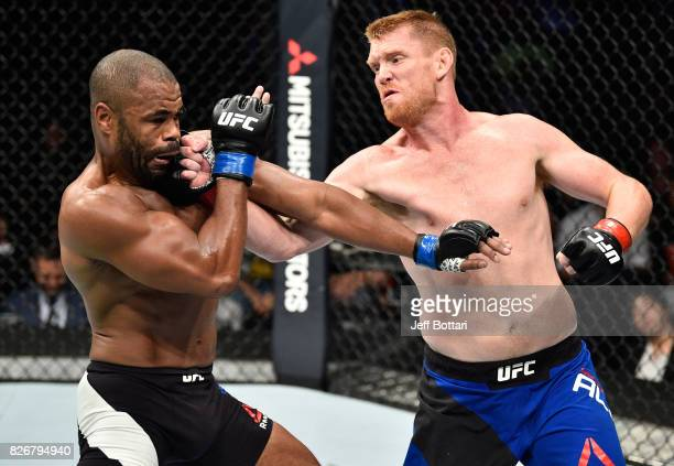 Sam Alvey punches Rashad Evans in their middleweight bout during the UFC Fight Night event at Arena Ciudad de Mexico on August 5 2017 in Mexico City...