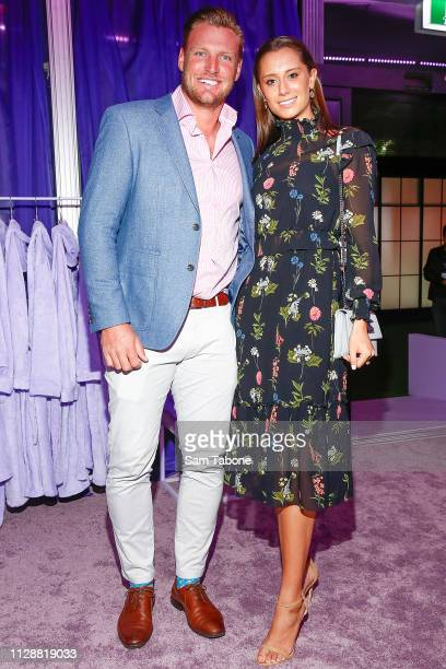 Sam and Brittany Groth attends the Grand Showcase Runway for Carla Zampatti at Melbourne Fashion Festival on March 6 2019 in Melbourne Australia