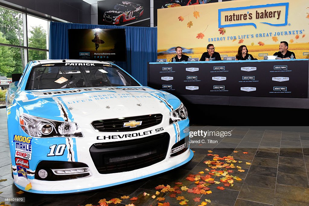 Sam and Dave Marson, co-founders of Nature's Bakery, Danica Patrick, driver of the #10 Stewart-Haas Racing Chevrolet, and Tony Stewart, co-owner of Stewart-Haas Racing, announce a multiyear deal partnership during a press conference on August 18, 2015 in Kannapolis, North Carolina. The partnership will begin with the 2016 NASCAR Sprint Cup Series season.