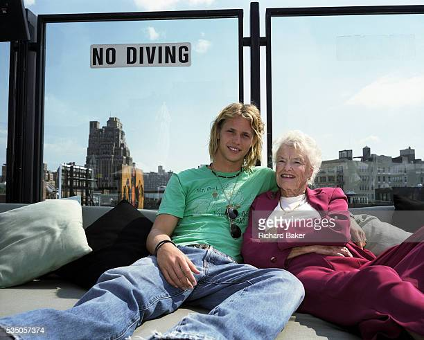 Sam and Eve Branson son and mother of tycoon Sir Richard relax together on a roof terrace in Manhattan New York Both are queueing to join the...