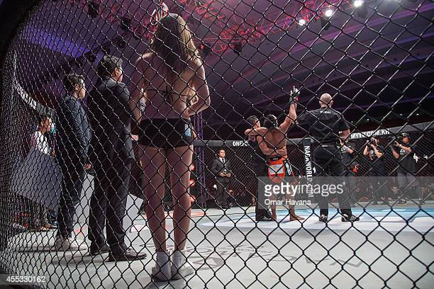 Sam Ang Dun is declared winner by the referees after his opponnent Chan Rothana was disqualified during One FC Cambodia on September 12 2014 in Phnom...