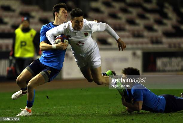 Sam AsplandRobinson of England tackled by D'Onofrio Giovanni and Rizzi Antonio of Italy during the U20 Six Nations match between England U20 and...