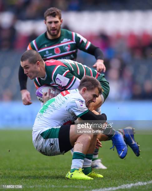 Sam AsplandRobinson of Leicester Tigers is tackles by Bastien Pourailly of Pau during the European Rugby Challenge Cup Round 1 match between...