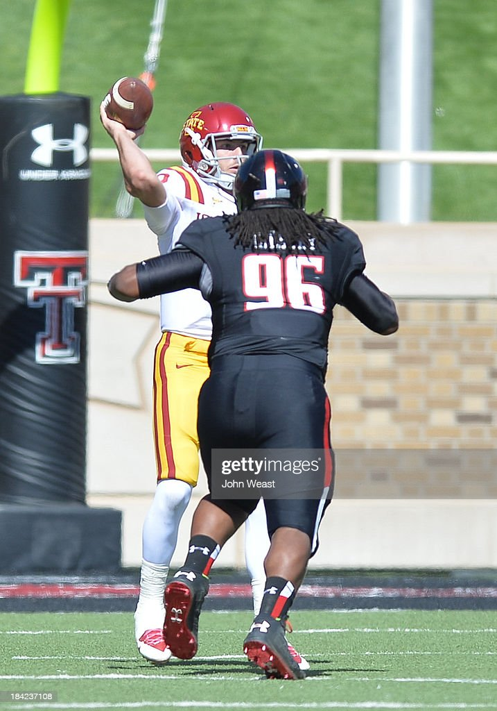 Sam B. Richardson #12 of the Iowa State Cyclones gets a pass rush from Dennell Wesley #96 of the Texas Tech Red Raiders during game action on October 12, 2013 at AT&T Jones Stadium in Lubbock, Texas. Texas Tech won the game over Iowa State 42-35.
