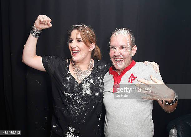 Sam Bailey and Jeremy Joseph have a cake fight backstage at GAY at Heaven on March 29 2014 in London United Kingdom