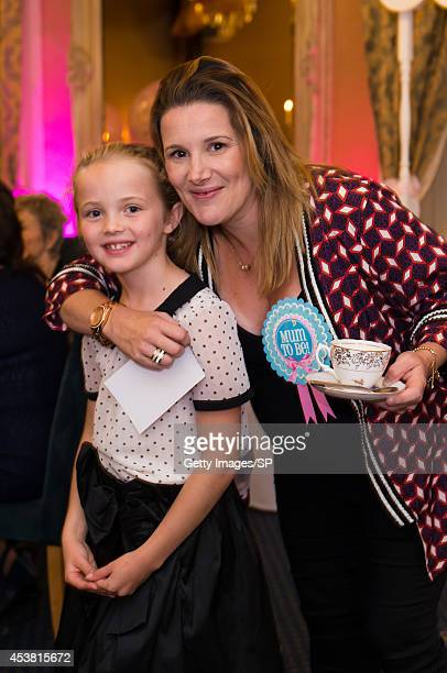Sam Bailey poses with her daughter Brooke Pearson at Sam's Baby Shower at The City Rooms on August 10 2014 in Leicester England