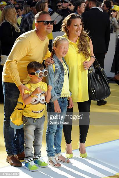 Sam Bailey poses with her famil Craig Pearson Tommy Pearson and Brooke Pearson attends the World Premiere of Minions at Odeon Leicester Square on...
