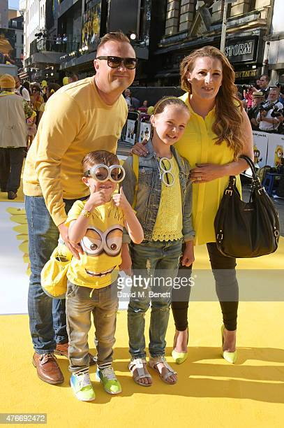 Sam Bailey poses with husband Craig Pearson and children Tommy Pearson and Brooke Pearson at the World Premiere of Minions at Odeon Leicester Square...