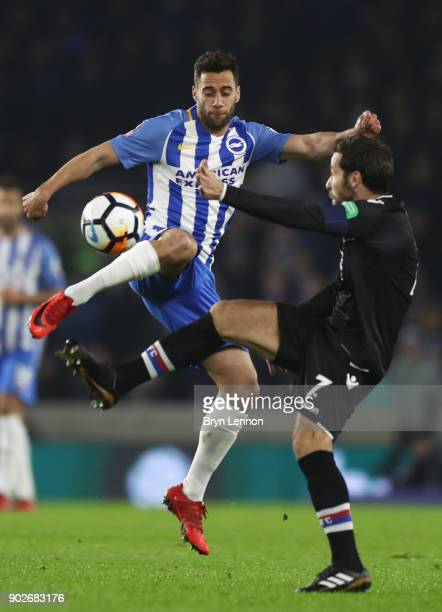 Sam Baldock of Brighton and Hove Albion and Yohan Cabaye of Crystal Palace battle for the ball during The Emirates FA Cup Third Round match between...