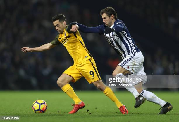 Sam Baldock of Brighton and Hove Albion is challenged by Grzegorz Krychowiak of West Bromwich Albion during the Premier League match between West...