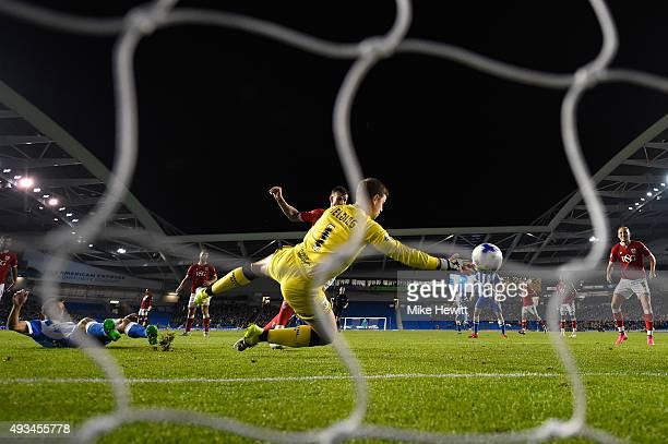 Sam Baldock of Brighton equalises despite the efforts of goalkeeper Frank Fielding and Aden Flint of Bristol City during the Sky Bet Championship...