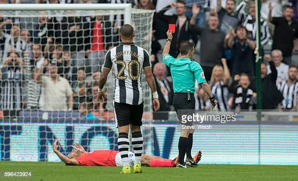 Sam Baldock of Brighton is shown a red card by Referee Keith Stroud after a second yellow during the Sky Bet Championship match between Newcastle...
