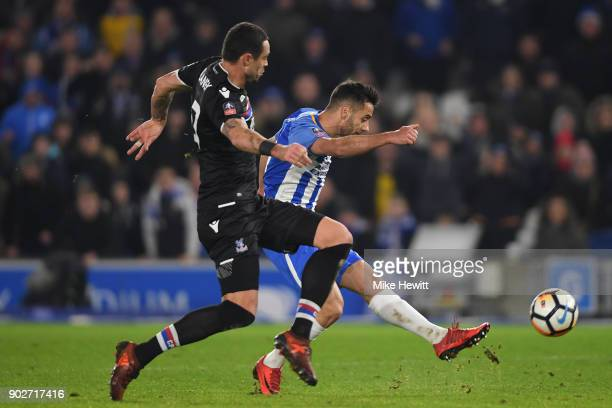 Sam Baldock of Brighton shoots wide under pressure from Damien Delaney of Crystal Palace during The Emirates FA Cup Third Round match between...