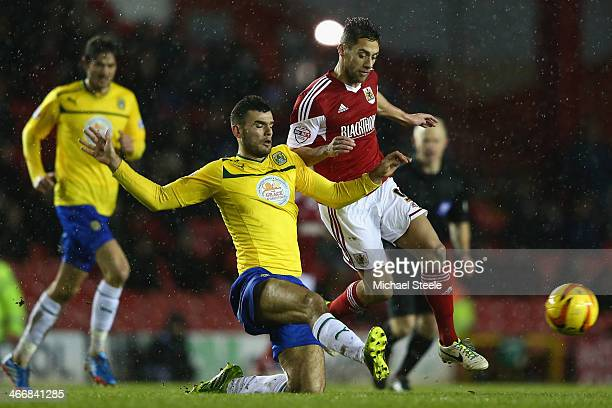 Sam Baldock of Bristol City is challenged by Conor Thomas of Coventry City during the Sky Bet League One match between Bristol City and Coventry City...