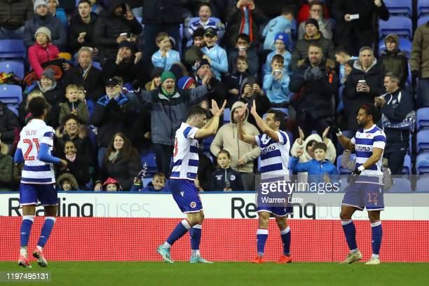 Sam Baldock of Reading celebrates with teammates after scoring his team's first goal during the FA Cup Third Round match between Reading FC and...