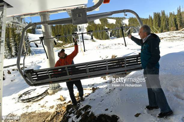 NEDERLAND CO NOVEMBER 9 Sam Bass middle public relations director and Brent Tregaskis right general manager look at one of the new chairs on the new...