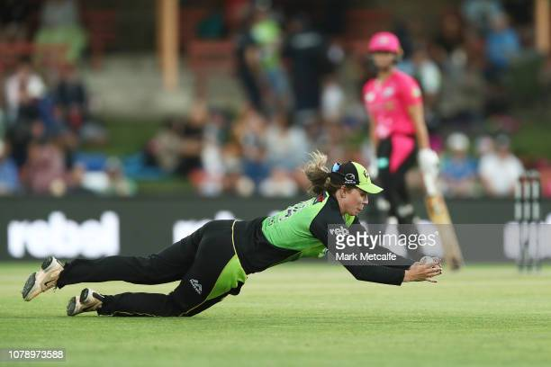 Sam Bates of the Thunder takes a catch to dismiss Ashleigh Gardner of the Sixers during the Women's Big Bash League match between the Sydney Sixers...